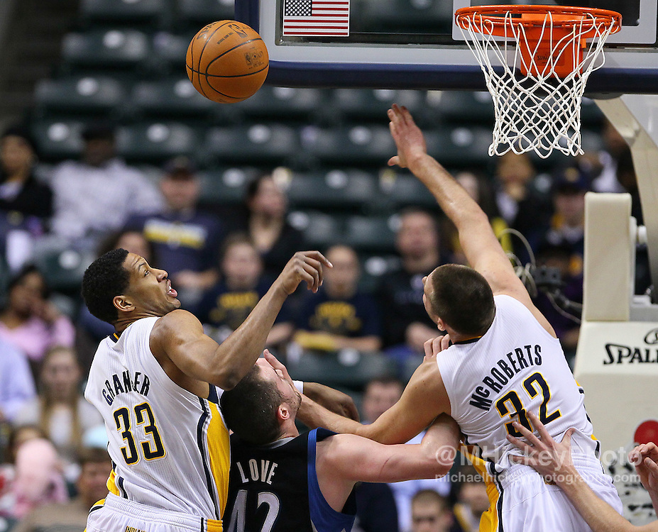 Feb. 11, 2011; Indianapolis, IN, USA; Indiana Pacers forward Danny Granger (33) and Indiana Pacers forward Josh McRoberts (32) battle for a rebound against Minnesota Timberwolves power forward Kevin Love (42) at Conseco Fieldhouse. Mandatory credit: Michael Hickey-US PRESSWIRE