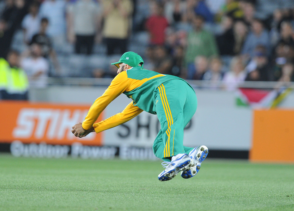 South Africa's Hashim Amla takes a diving catch to dismiss New Zealand's Doug Bracewell for 0 in the third twenty/20 International Cricket match, Eden Park, Auckland, New Zealand, Wednesday, February 22, 2012. Credit:SNPA / Ross Setford
