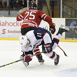 WELLINGTON, - Dec 11, 2015 -  Exhibition Game 2- Team Canada East vs Team USA at the 2015 World Junior A Challenge at the Wellington District Community Centre, ON. Callahan Burke #11 of Team United States takes the hit from Maxime St. Pierre #25 of Team Canada East during the first period.<br />