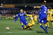 Sutton United midfielder Craig Eastmond (15) tackling AFC Wimbledon midfielder Dean Parrett (18) during the The FA Cup third round replay match between AFC Wimbledon and Sutton United at the Cherry Red Records Stadium, Kingston, England on 17 January 2017. Photo by Matthew Redman.