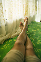 Male legs and feet in relaxed pose&#xA;<br />