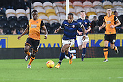 Hull City midfielder Moses Odubajo and Bolton Wanderers midfielder Neil Danns  during the Sky Bet Championship match between Hull City and Bolton Wanderers at the KC Stadium, Kingston upon Hull, England on 12 December 2015. Photo by Ian Lyall.