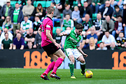 Lewis Stevenson (#16) of Hibernian crosses the ball for Jamie Maclaren (#19) of Hibernian to score Hibernian's first goal (1-0) during the Ladbrokes Scottish Premiership match between Hibernian and Celtic at Easter Road, Edinburgh, Scotland on 21 April 2018. Picture by Craig Doyle.