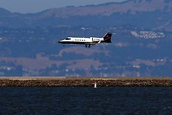 Learjet 60 (C-FJGG) landing at San Francisco International Airport (KSFO), San Francisco, California, United States of America