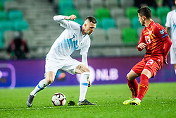Enis Bardi of Macedonia vs Josip Iličić of Slovenia during football match between National teams of Slovenia and North Macedonia in Group G of UEFA Euro 2020 qualifications, on March 24, 2019 in SRC Stozice, Ljubljana, Slovenia.  Photo by Matic Ritonja / Sportida