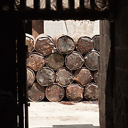 Olive oil barrels at a traditional soap factory, Aleppo, Syria