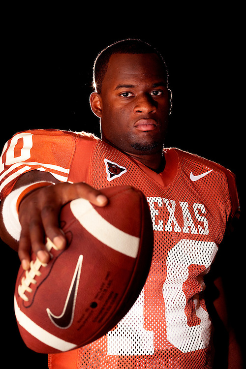 Vince Young, Quarterback #10, University of Texas Longhorns. Photographed in the Texas Locker Room at Darrell K. Royal-Texas Memorial Stadium  on July 25, 2005. Photograph © 2005 Darren Carroll