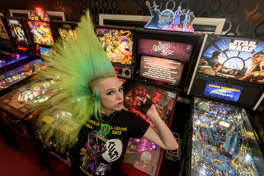 A photoshoot with New York City Artist and Hairstylist Antoinette Johnson as she poses with her Tri-hawk ™ and pinball and video games Friday, Dec. 22, 2017 in the arcade at Zanzabar in Louisville, Ky. (Photo by Brian Bohannon)