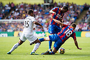 Swansea City (15) Wayne Routledge, Crystal Palace #18 James McArthur, Crystal Palace #42 Jason Puncheon (captain) during the Premier League match between Crystal Palace and Swansea City at Selhurst Park, London, England on 26 August 2017. Photo by Sebastian Frej.