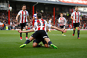 Brentford Sergi Canos (47) and Brentford defender Yoann Barbet (29) celebrate his goal (score 1-0) during the EFL Sky Bet Championship match between Brentford and Queens Park Rangers at Griffin Park, London, England on 22 April 2017. Photo by Andy Walter.