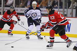 Jan 17; Newark, NJ, USA; New Jersey Devils right wing David Clarkson (23) skates with the puck during the second period at the Prudential Center.