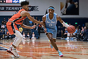 San Diego Toreros guard Marion Humphrey (0) drives against Cal State Fullerton Titans guard Tory San Antonio (23) during an NCAA basketball game, Wednesday, Dec. 11, 2019, in Fullerton, Calif. San Diego defeated CSUF 66-54. (Jon Endow/Image of Sport)