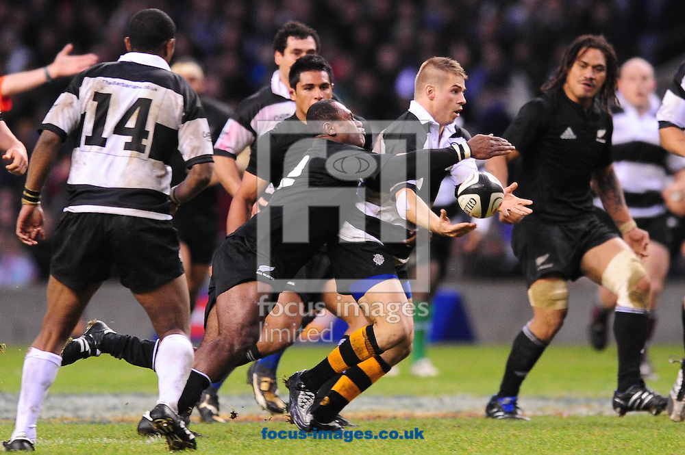 London - Saturday, December 5th 2009: Sitiveni Sivivatu of New Zealand tackles Drew Mitchell of Barbarians  during the game at Twickenham, London. ..(Pic by Alex Broadway/Focus Images)