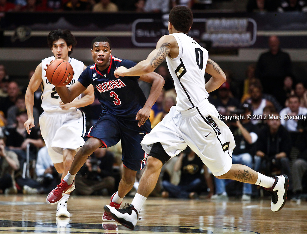 SHOT 1/21/12 6:50:15 PM - Colorado's  Arizona's Kevin Parrom #3 dribbles past Colorado's Askia Booker #0 and Sabatino Chen #23 during their PAC 12 regular season men's basketball game at the Coors Events Center in Boulder, Co. Colorado won the game 64-63..(Photo by Marc Piscotty / © 2012)