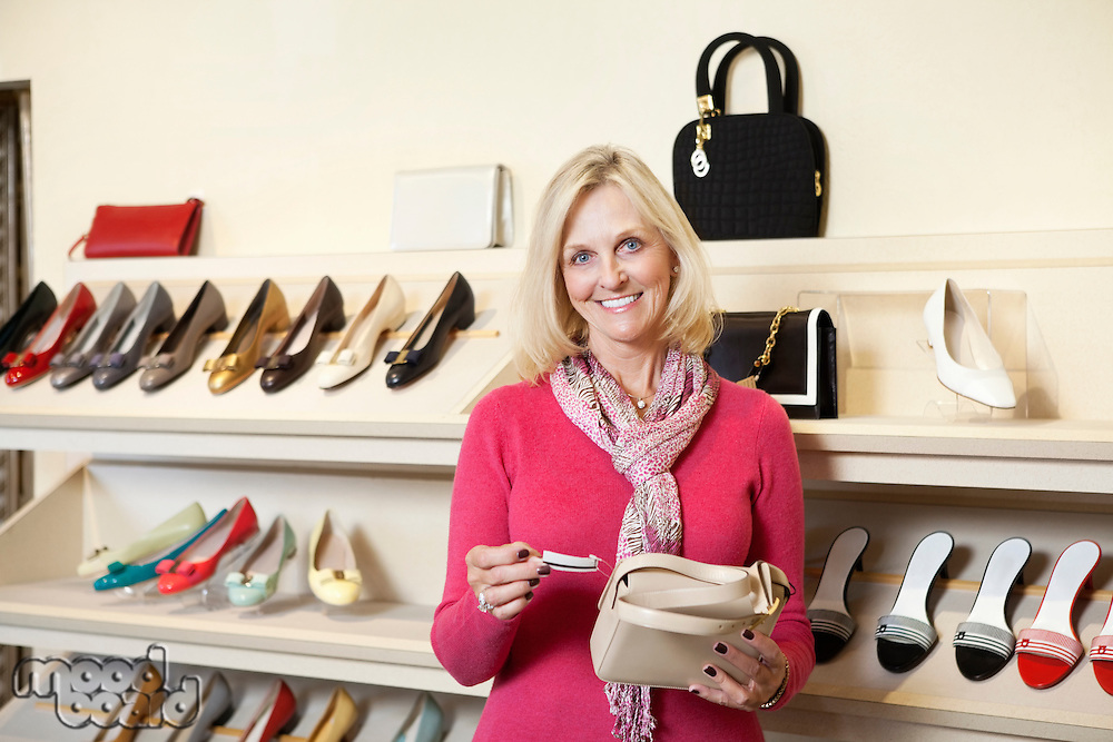 Portrait of a mature woman with purse in store