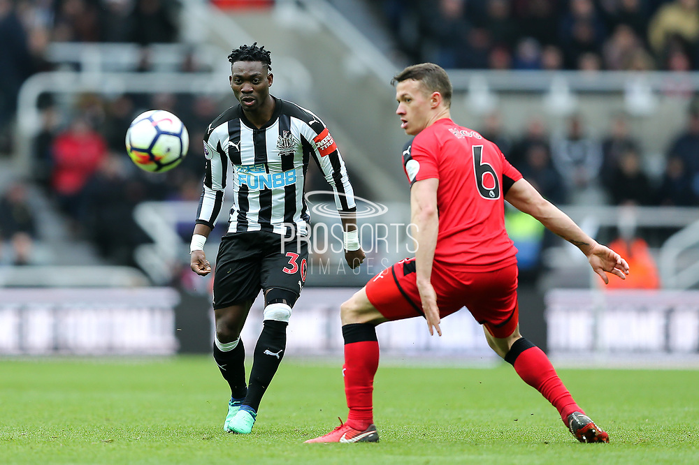 Christian Atsu (#30) of Newcastle United chips a pass in the direction of Jonjo Shelvey (#8) of Newcastle United during the Premier League match between Newcastle United and Huddersfield Town at St. James's Park, Newcastle, England on 31 March 2018. Picture by Craig Doyle.