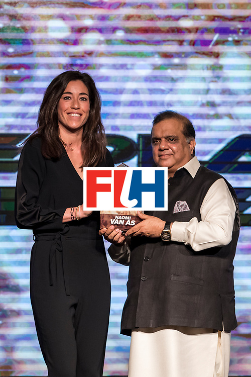 CHANDIGARH, INDIA - FEBRUARY 23: Dr. Narinder Dhruv Batra [R], President of The International Hockey Federation presents the FIH Female Player of the Year award to Naomi Van As [L] of Netherlands during the FIH Hockey Stars Awards 2016 at Lalit Hotel on February 23, 2017 in Chandigarh, India. (Photo by Ali Bharmal/Getty Images for FIH)