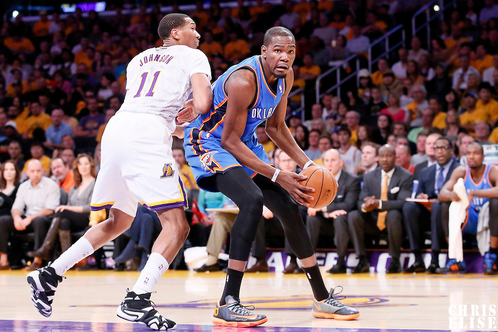 09 March 2014: Oklahoma City Thunder small forward Kevin Durant (35) drives past Los Angeles Lakers small forward Wesley Johnson (11) during the Los Angeles Lakers 114-110 victory over the Oklahoma City Thunder at the Staples Center, Los Angeles, California, USA.
