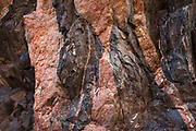 Contrasting rock layers of black Vishnu schist and pink Zoroaster granite. In the Granite Gorge along the Colorado River near mile 82 in Grand Canyon National Park.