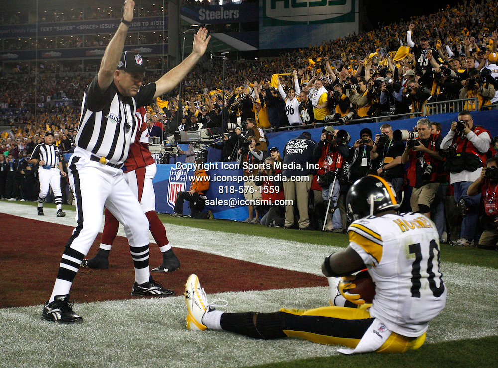 Feb 01, 2009 - Tampa, Florida, USA - Santonio Holmes (10) holds the ball as the referee signals touchdown in the fourth quarter..Super Bowl XLIII between the Arizona Cardinals and the Pittsburgh Steelers on February 1, 2009 at Raymond James Stadium