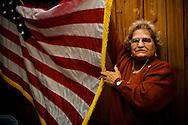 """Senior Center on 187st @ Souther Boulevard, Bronx.Angelina Zagami, figlia di immigranti italiani, nata in terra americana, sorregge la bandiera a stelle e striscie cantando l'inno nazionale americano..A settimane alterne, il martedi? e? il giorno in cui al Senior Center di Belmont si suona musica dal vivo e si balla classici italiani anni 50, 60 e 70. Ogni """"sessione"""" si chiude cantando tutti insieme """"The Star Spangled Banner""""..volontaria al centro, referente, in maglia viola.Ann Mondelli.real estate brooker.914.776.6840.917.837.7625.61 bronx river road.Yonkers, 10704 NY.ap 2G"""