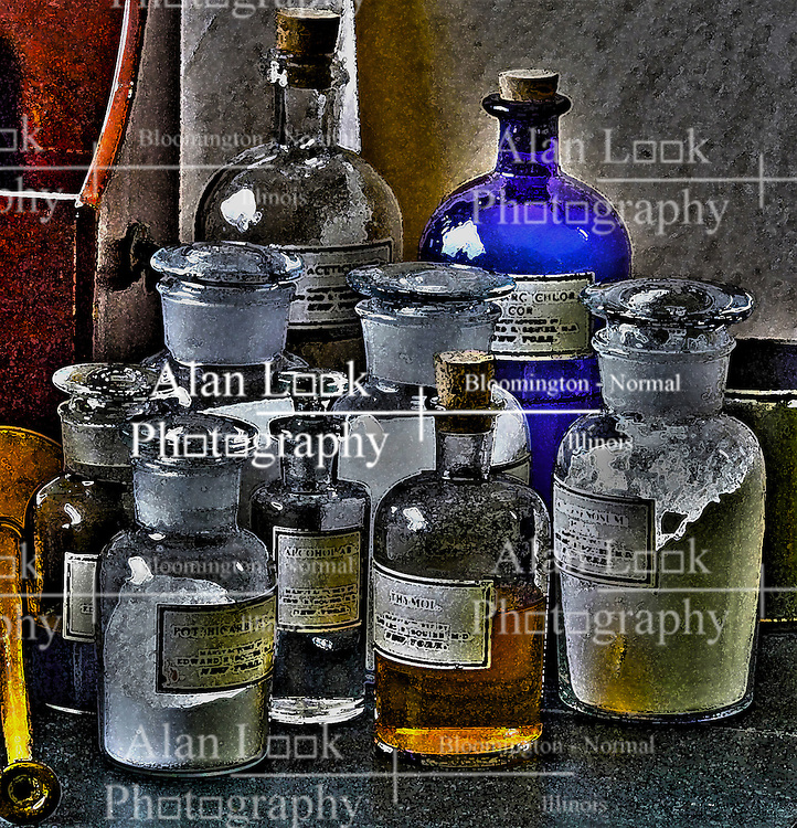 Assorted drugs in apothecary bottles.