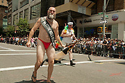 Mike Fass, winner of the 2011 Mr. Tonewall Bear competition, in the 2011 Pride Parade on New York's Fifth Avenue. The Stonewall Inn was the site of the 1969 riots, considered the origin on the gay pride movement.