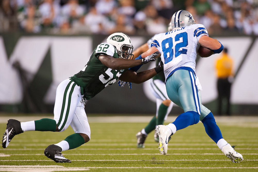 EAST RUTHERFORD, NJ - SEPTEMBER 11: David Harris #52 of the New York Jets defends against the Dallas Cowboys at MetLife Stadium on September 11, 2011 in East Rutherford, New Jersey. The Jets defeated the Cowboys 27 to 24. (Photo by Rob Tringali) *** Local Caption *** David Harris