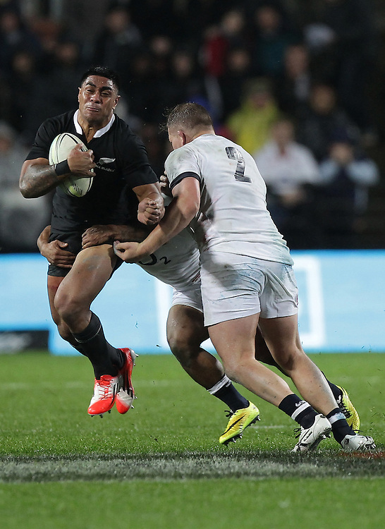 New Zealand's Malakai Fekitoa is tackled by England's Dylan Hartley  in an International Rugby Test match, Waikato Stadium, Hamilton, New Zealand, Saturday, June 21, 2014.  Credit:SNPA / David Rowland