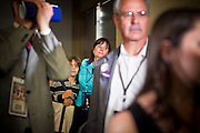 02 NOVEMBER 2010 - PHOENIX, AZ: Kevin Goddard and his mom, Monica Goddard, wait for Terry Goddard to finish after his concession speech on election night at the Wyndham Hotel in Phoenix Tuesday. Goddard lost the election to sitting Governor Jan Brewer, a conservative Republican.     PHOTO BY JACK KURTZ