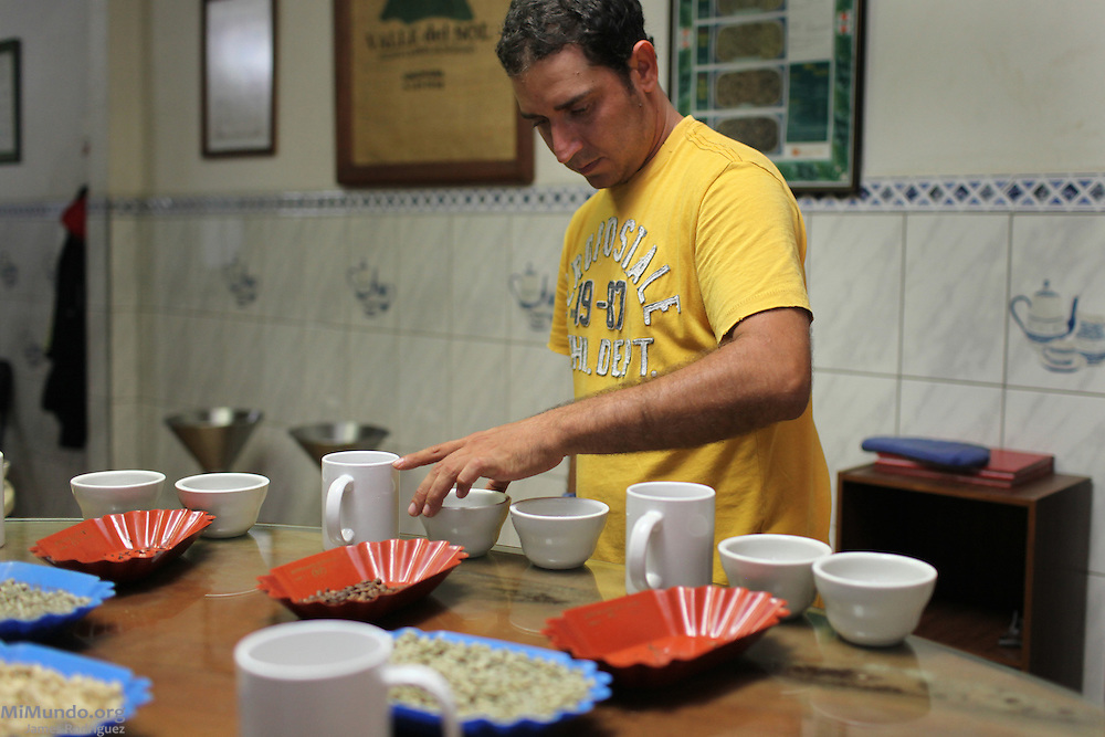 Julio Barrantes Vargas, quality control coordinator for the Victoria Industrial Agricultural Co-operative, prepares a coffee tasting session. COOPEVICTORIA, San Isidro de Grecia, Alajuela, Costa Rica. August 21, 2012.