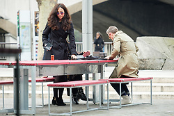 © Licensed to London News Pictures. 13/03/2018. London, UK. Actor MARTIN FREEMAN is seen having coffee with an unidentified woman wearing sunglasses and a dark raincoat in The Southbank area of the River Thames. Photo credit: London News Pictures