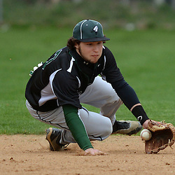 Staff photos by Tom Kelly IV<br /> Ridley shortstop Jake Hoffman (27) makes a sliding stop on a hard hit ground ball during the Ridley at Strath Haven baseball game on Thursday afternoon.