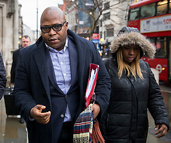 © Licensed to London News Pictures. 15/01/2018. London, UK. Lanre Haastrup and Takesha Thomas , the parents of nine-month-old Isaiah Haastrup arrive at the High Court. The family of Isaiah are fighting for further treatment of their son, who cannot breathe for himself and has cerebal palsy following birth complications at Kings College Hospital. Mr Haastrup was banned from the hospital in November last year, following an incident. Photo credit : Tom Nicholson/LNP