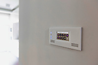 Close up photo of modern touch switch board on wall