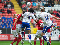 LONDON, ENGLAND - Saturday, October 8, 2011: Tranmere Rovers' Ian Goodison and Ash Taylor both go up for the corner against Charlton Athletic during the Football League One match at The Valley. (Pic by Gareth Davies/Propaganda)