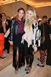 Left to right, ALEX MEYERS and PIPPA VOSPER at the Roger Vivier 'The Perfect Pair' Frieze cocktail party celebrating Ambra Medda & 'Miss Viv' at the Roger Vivier Boutique, Sloane Street, London on 15th October 2014.