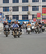 Commuters go to work after the mid-day break in Longnan, China.