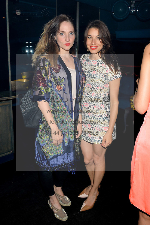 Left to right, JESSICA MILLER and LAUREN KEMP at a summer party hosted by Jo Wood & Yasmin Mills at Boujis, 43 Thurloe Street, London on 9th July 2014.