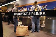 Southwest Airlines passengers arrive at Philadelphia International Airport December 29, 2005 in Philadelphia, Pennsylvania. (Photo by William Thomas Cain)