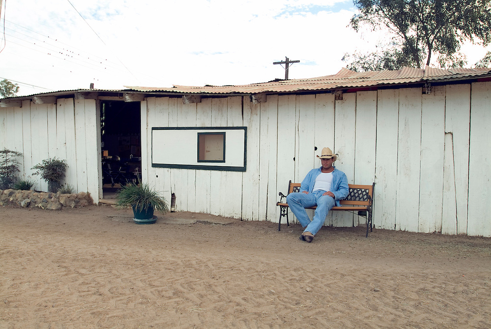 Lifestyle portrait of a rancher resting outside in San Diego, CA.