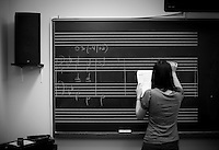 Student Rae Feldcamp, 21, of Medford, NJ, performs an exercise on the chalkboard during a session of her Harmony II music theory class at the Curtis Institute of Music in Philadelphia on December 2, 2009.