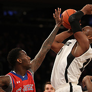 Kadeem Batts, (right), Providence, has his shot blocked by  JaKarr Sampson, St. John's, during the Providence Vs St. John's Red Storm basketball game during the Big East Conference Tournament at Madison Square Garden, New York, USA. 12th March 2014. Photo Tim Clayton
