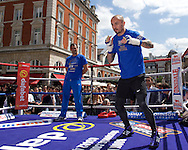 Kevin Mitchell is watched shadow boxing by Trainer Tony Sims during a public workout in Covent Garden, London<br /> Picture by Alan Stanford/Focus Images Ltd +44 7915 056117<br /> 26/05/2015