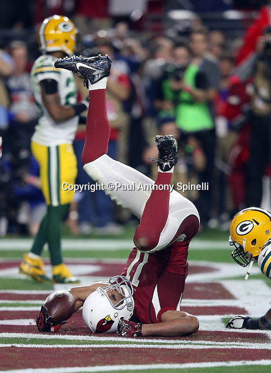 Arizona Cardinals wide receiver Larry Fitzgerald (11) flips upside down after catching an overtime pass for the winning touchdown during the NFL NFC Divisional round playoff football game against the Green Bay Packers on Saturday, Jan. 16, 2016 in Glendale, Ariz. The Cardinals won the game in overtime 26-20. (©Paul Anthony Spinelli)