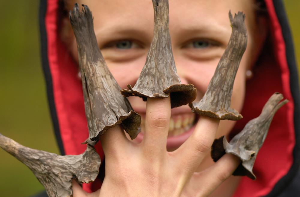 Liisa Widstrand with Black trumpet mushroom, Craterellus cornucopioides, Sweden