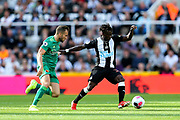 Christian Atsu (#30) of Newcastle United controls the ball under pressure during the Premier League match between Newcastle United and Watford at St. James's Park, Newcastle, England on 31 August 2019.