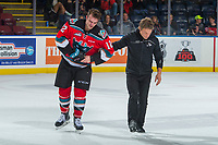 KELOWNA, CANADA - OCTOBER 27: Kelowna Rockets' Athletic Therapist Scott Hoyer assists Erik Gardiner #12 off the ice after an injury against the Tri-City Americans on October 27, 2017 at Prospera Place in Kelowna, British Columbia, Canada.  (Photo by Marissa Baecker/Shoot the Breeze)  *** Local Caption ***