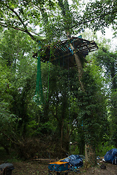 A tree house built by environmental activists from HS2 Rebellion to try to prevent the destruction of trees in conjunction with the HS2 high-speed rail link in Denham Country Park on 13th July 2020 in Denham, United Kingdom. The HS2 project is currently projected to cost around £106bn and will remain a net contributor to CO2 emissions during its projected 120-year lifetime.