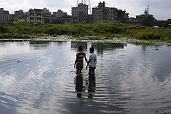 July 13, 2017 - Dhaka, Bangladesh - Two boys are trying to catch fish from polluted water near Buriganga River at Dhaka. (Credit Image: © Md. Mehedi Hasan/Pacific Press via ZUMA Wire)